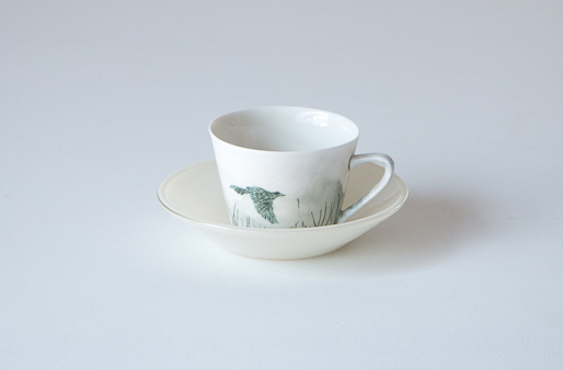 cup and saucer with wattlebird