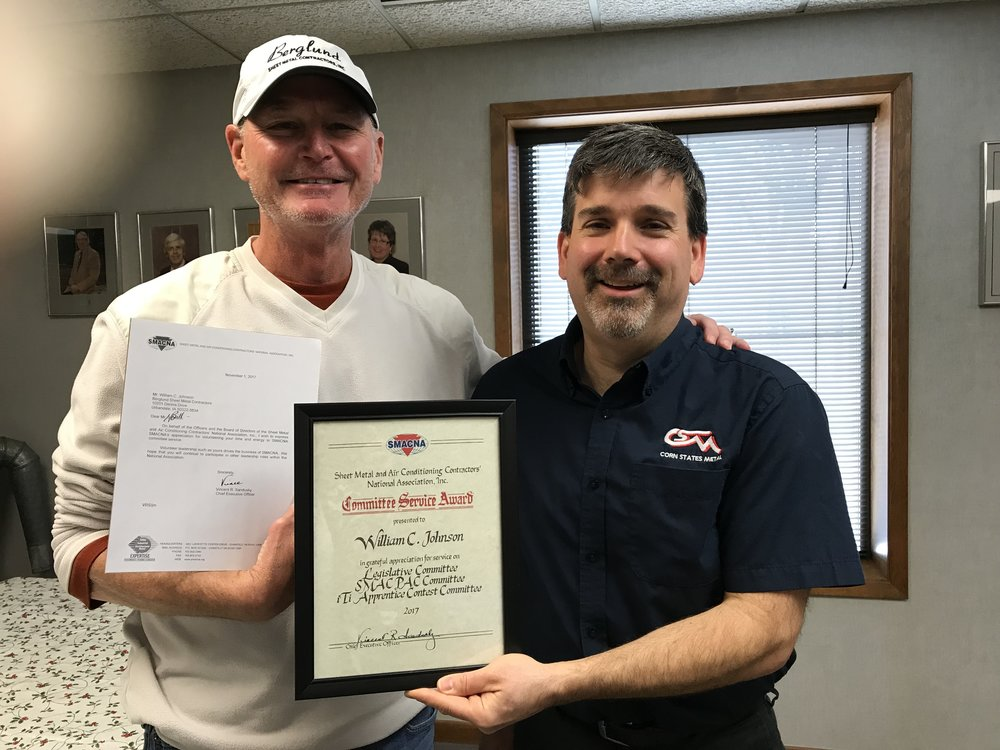 SMCI President Mitch Golay presents Bill Johnson with a certificate from SMACNA.