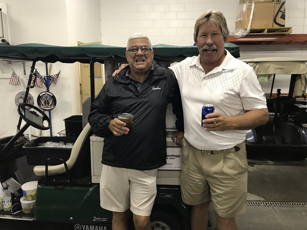 Don Livasy and Doyle Bunting made the most of the rain delay in the cart barn.