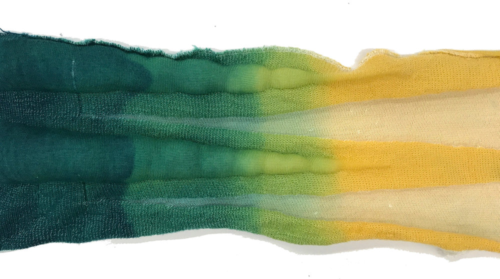 Knitted with 2/30 merino wool and plied monofilament and polyester as pocketed jacquard Two tone acid dyed, taken in by the protein fiber and allowing synthetic fiber to keep the transparency with pockets stuffed for volume
