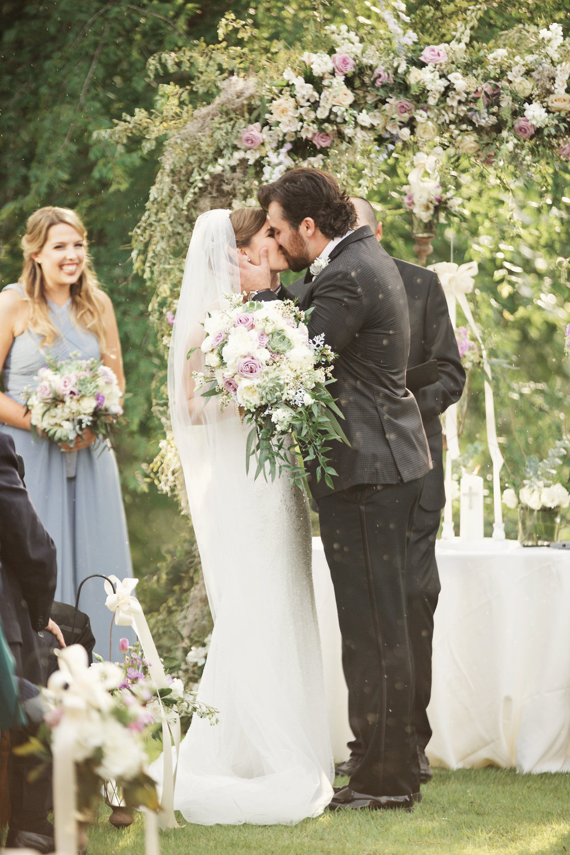 Rachel Slauer Events River Club May Wedding Planning Ceremony Kiss 27.jpg