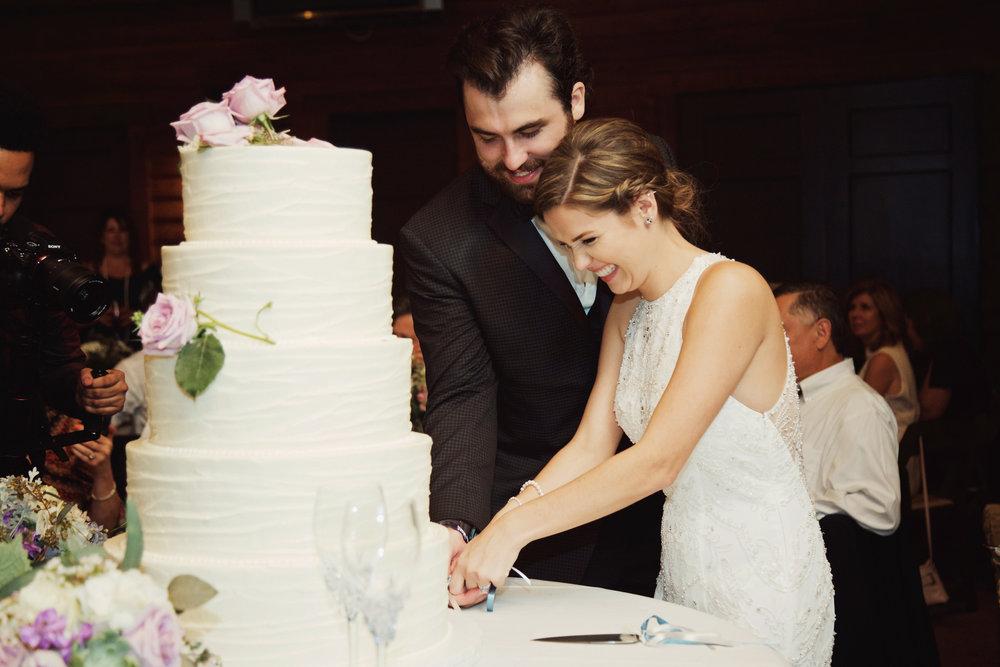 Rachel Slauer Events River Club May Wedding Planning Cake Cutting 08.jpg