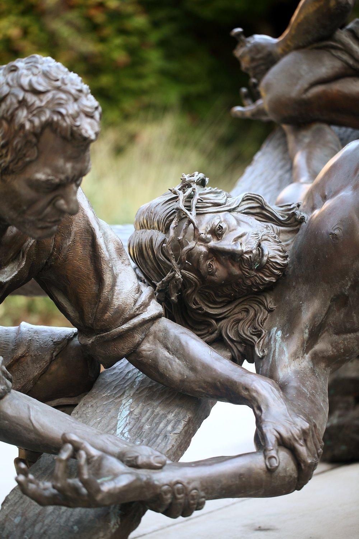 Slatoff_Jesus Being Nailed to the Cross_Bronze_atPrayerGarden_0012.jpg