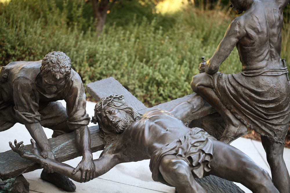 Slatoff_Jesus Being Nailed to the Cross_Bronze_atPrayerGarden_0013.jpg