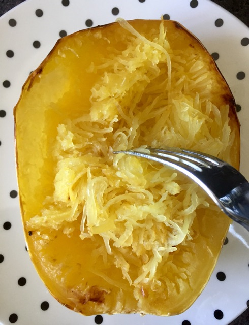 TIP: The longer the spaghetti squash is cooked, the easier it detaches from the skin, making you less likely to tear the 'boat'!