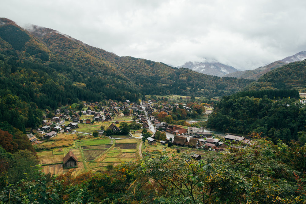 View of Shirakawa-go and the surrounding mountains. Visiting in early Autumn, we were probably a couple of weeks too early for the full colour change and a couple of months early for the heavy snow that the area is known for. One of the most iconic photos of this village is of the thatched roofs sitting under a thick layer of snow.