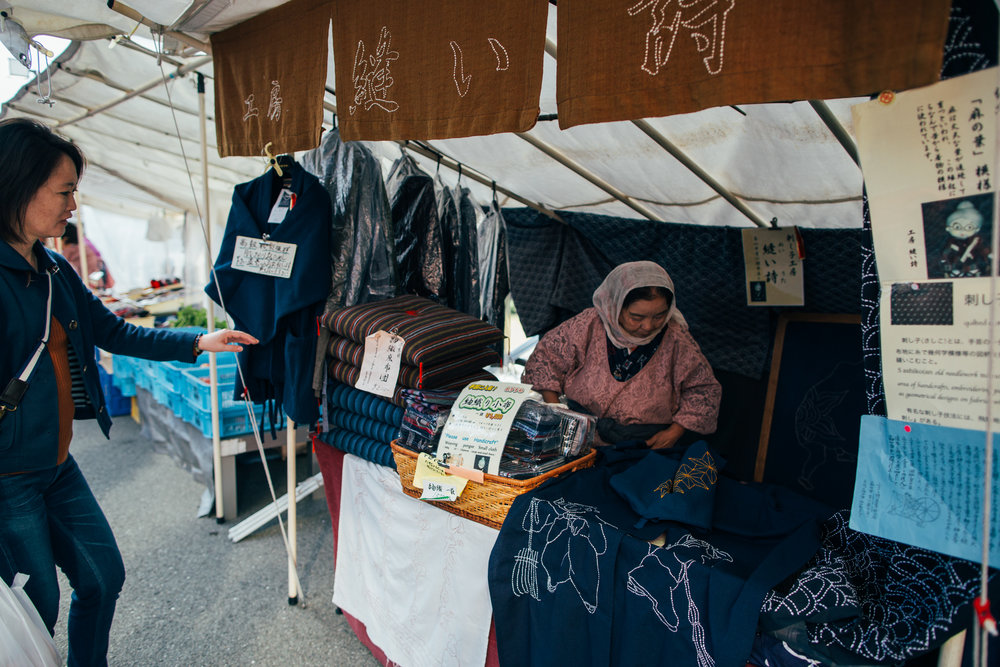 A vendor selling traditional Japanese robes with hand stitched designs. Not particularly cheap, but of course you are paying for the craftsmanship and skill.