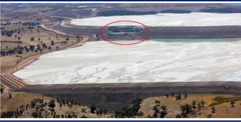 Figure 1. Photo of failure on northern dam wall. Southern dam in the foreground (Source: NCM)