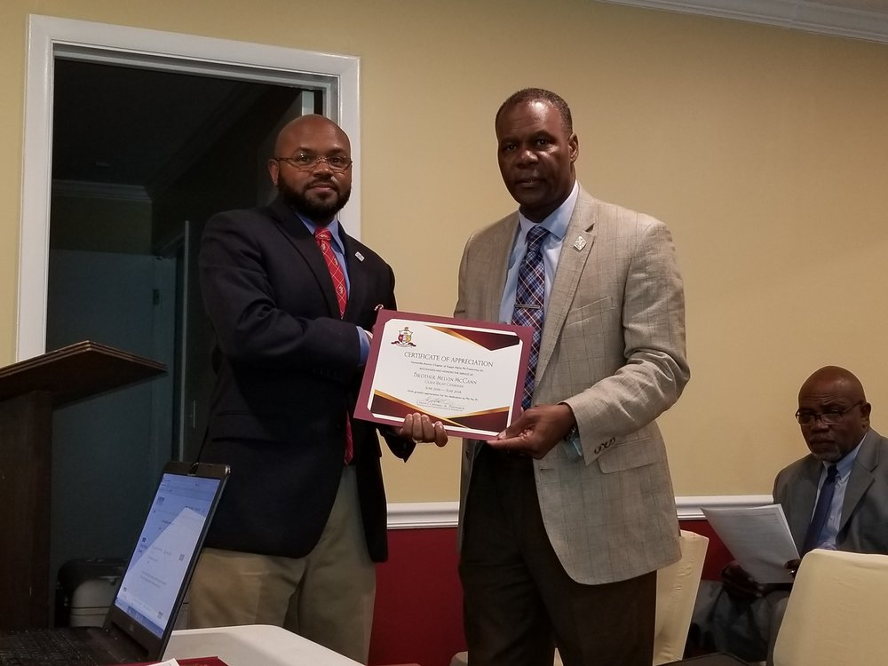 Honoring Brother McCann! - Brother Melvin McCann (left) receives the Polemarch's Award and a Certificate of Appreciation from HAC Immediate Past Polemarch Carlen J. Chestang, Jr.Brother McCann has served as the Kappa League and Guide Right Director for the past several years. He is totally dedicated and represents our chapter, the Guide Right mission and the young men in the local community with selfless service and dedication. Thanks for your service, Brother McCann!