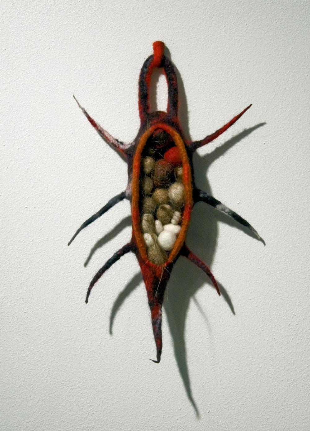 Smuggler (2010). Felt, human hair & thread.