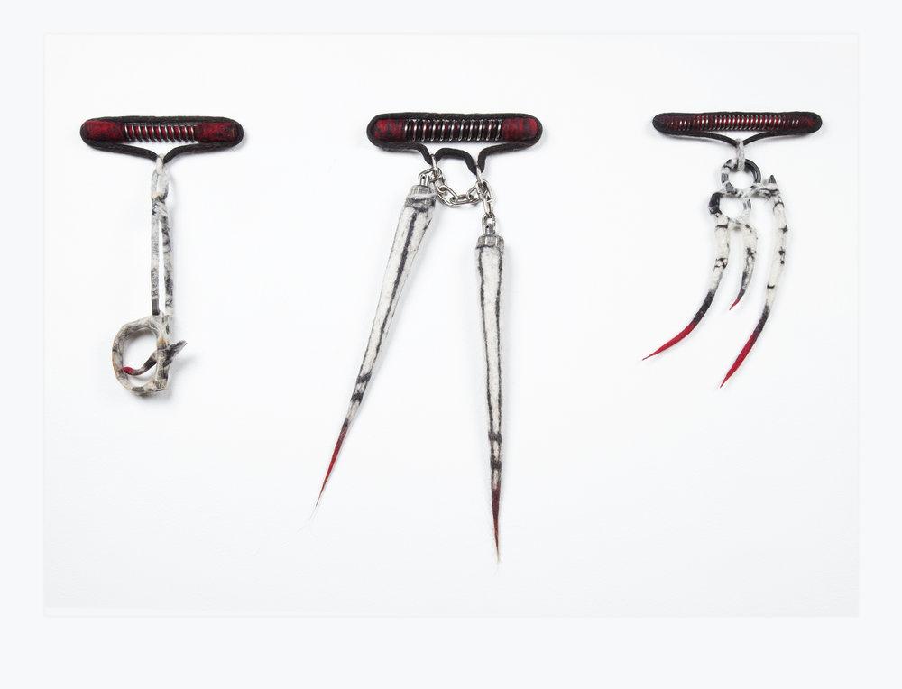 Single Action Lockdown I, II & III (2014). Trigger, Nunchaku & Knuckleduster, rifle springs, felt & human hair.