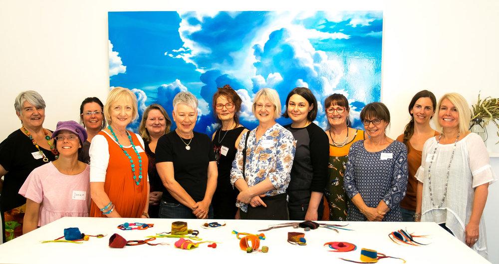 Participants at a textiles and felt workshop