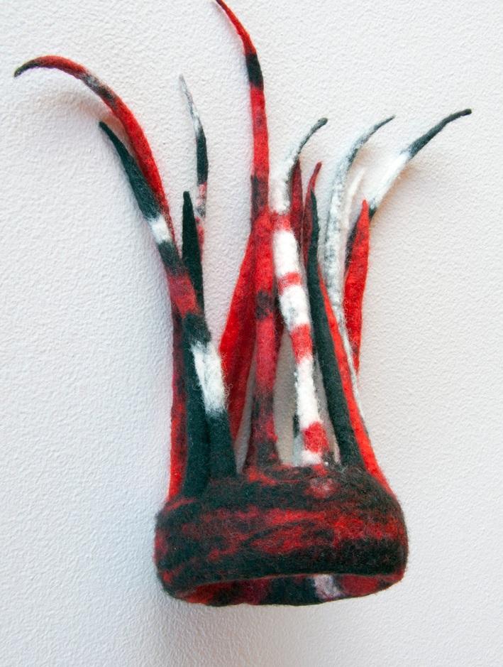 Katzenjammer bangle (2010). Fine merino wool felted.