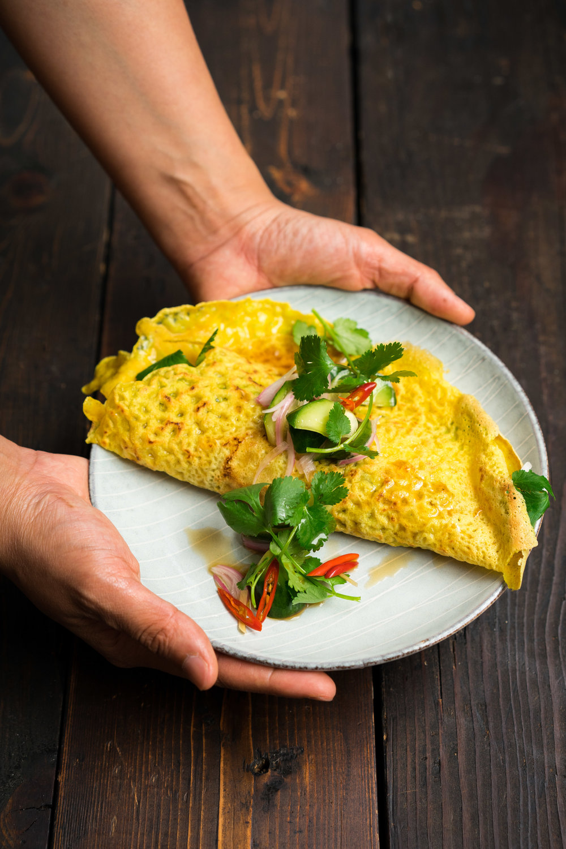 Kanom bueng von | ขนมเบื้องญวน: coconut-turmeric crepe, tofu, shrimp, bean sprouts, scallions, peanuts, mint, cilantro