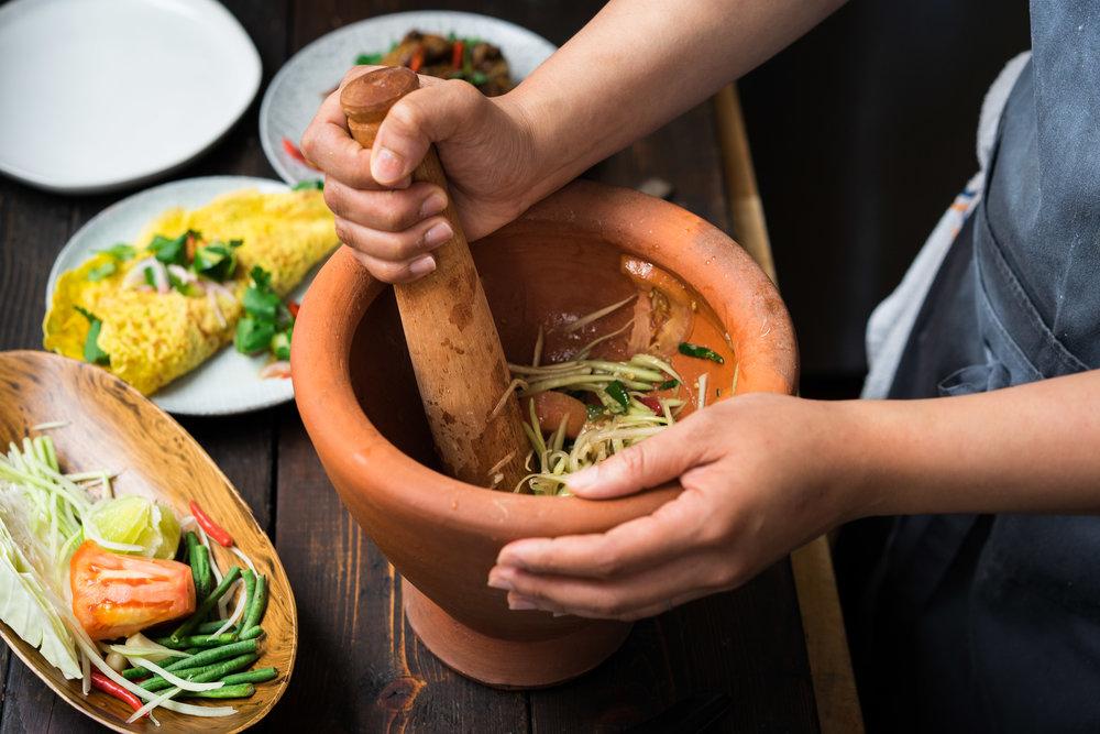 Chef Lalita Kaewsawang worked on Som Tum, a green papaya salad.