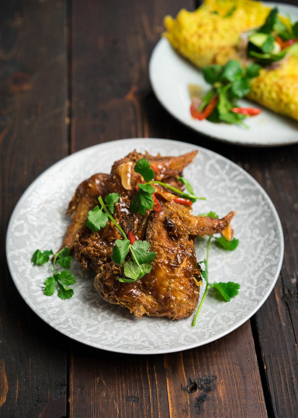 Gai tod | ไก่ทอด: fried chicken wings,* lemongrass marinade, fish sauce caramel, bird's eye chili, garlic. *Wings from Fogline Farm!