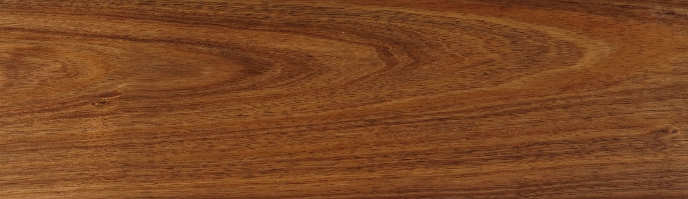 Tasmanian Blackwood   (Acacia Melanoxylon)   Blackwood is a medium-sized Australian hardwood that grows from eastern South Australia to southern QLD coastal areas. In the wetter areas of Tasmania it is grown in large volumes.  It is definitely an 'appearance timber', with a heartwood that is a rich golden brown. This is sometimes complimented by reddish streaks or a narrow band of darker colour, indicative of the growth rings. The sapwood is much paler in appearance. Blackwood has a medium and even texture. Its grain can either be straight or have a wavy fiddleback pattern.