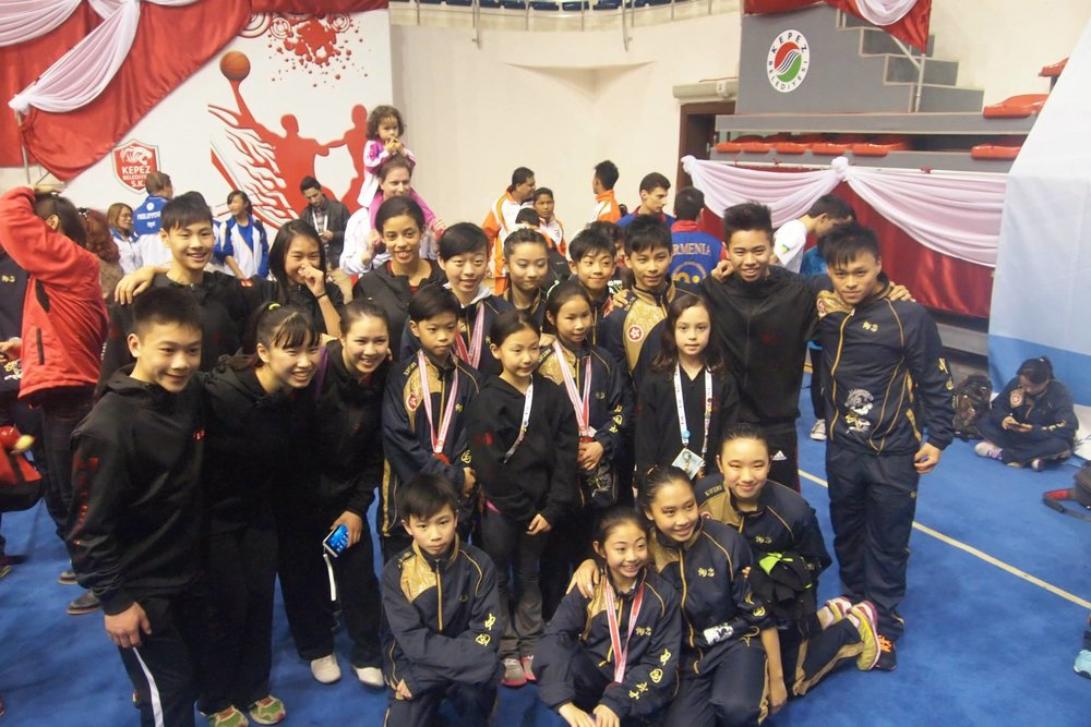 Teams Canada and Hong Kong at the 5th World Junior Wushu Championships, 2014.