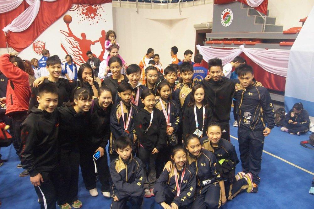 Teams Canada and Hong Kong at the 5th World Junior Wushu Championships, 2014.