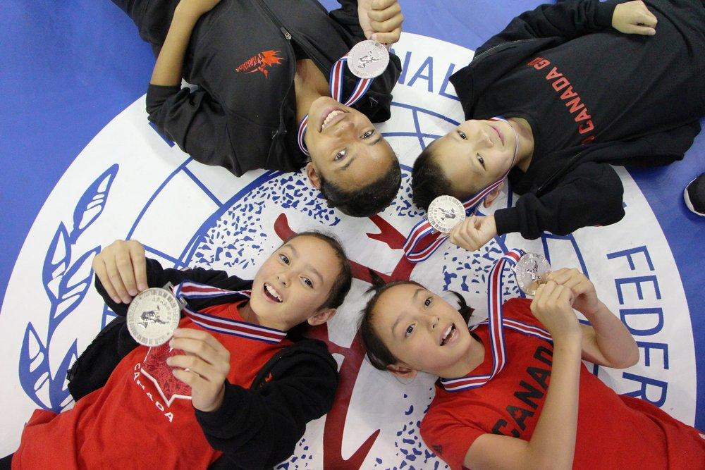 Teams Canada and Hong Kong  at the 6th World Junior Wushu Championships, 2016.