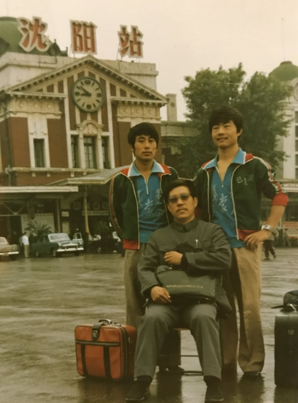 Wayland Li (李文启) standing left with his teammate Zhang Jianguo (张建国) standing right, and Coach Yang (sitting). Location: Luoyang, Henan province, China.
