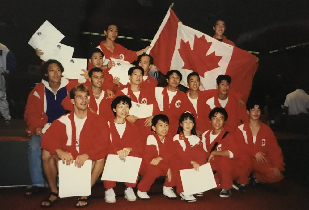 Leading the Canadian team at 3rd World Wushu Championships, 1995
