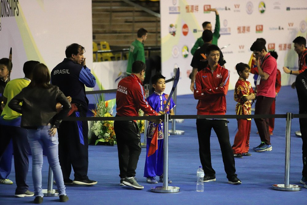 Mentoring athlete at 2018 World Junior Wushu Championships