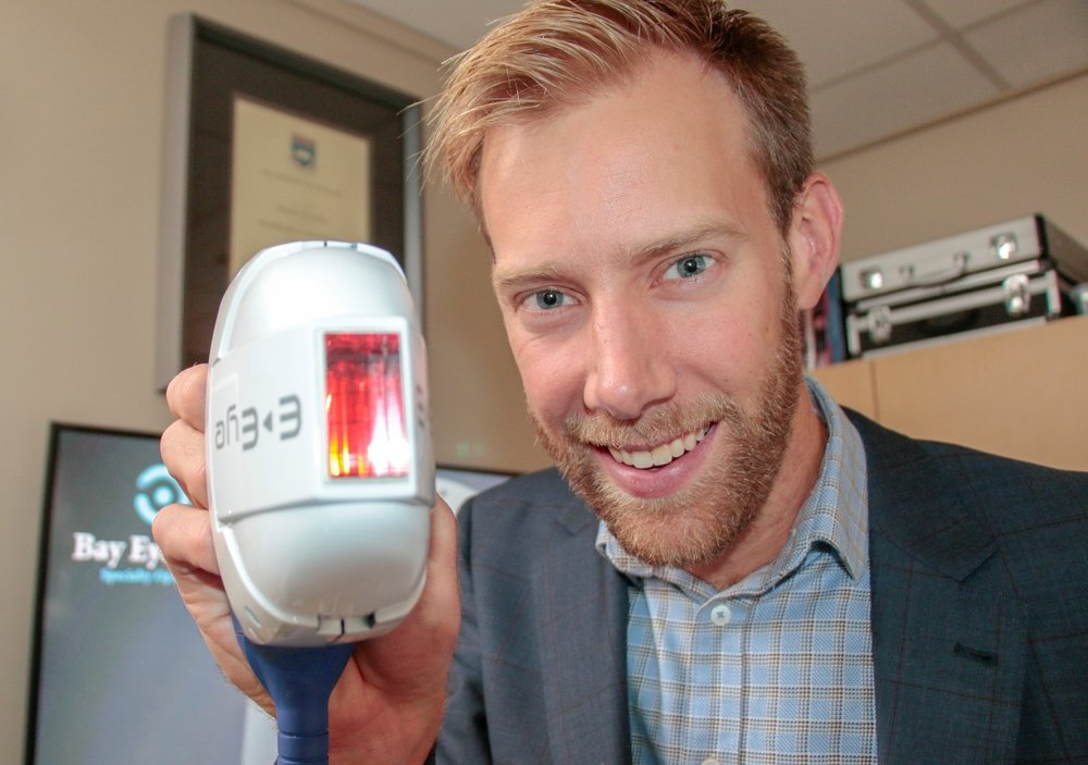 Our optometrist Mr Alex Petty with the IPL applicator for treating dry eye.