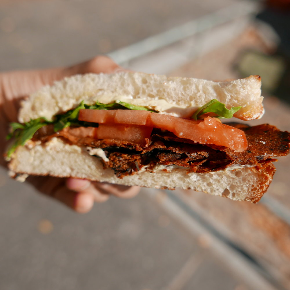 Basil BLT - heirloom tomatoes, adzuki bean bacon, arugula, basil mayo on toasted sourdough