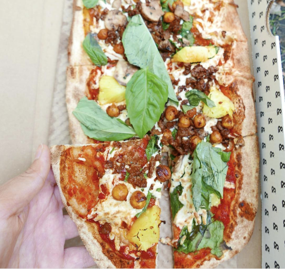 Make your own pizza with tomato sauce, pineapple, veggie sausage, pineapple, hot chickpeas, basil, and spinach