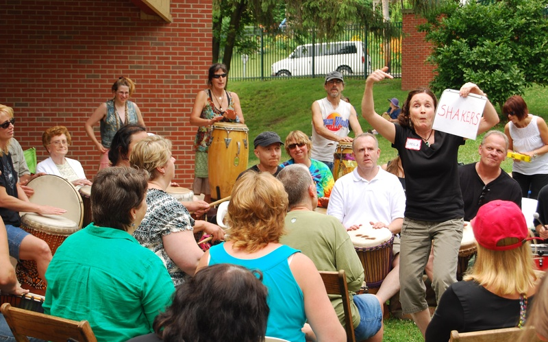 Drum Circle Leadership Trainee Shiela McEntee communicates with her group...