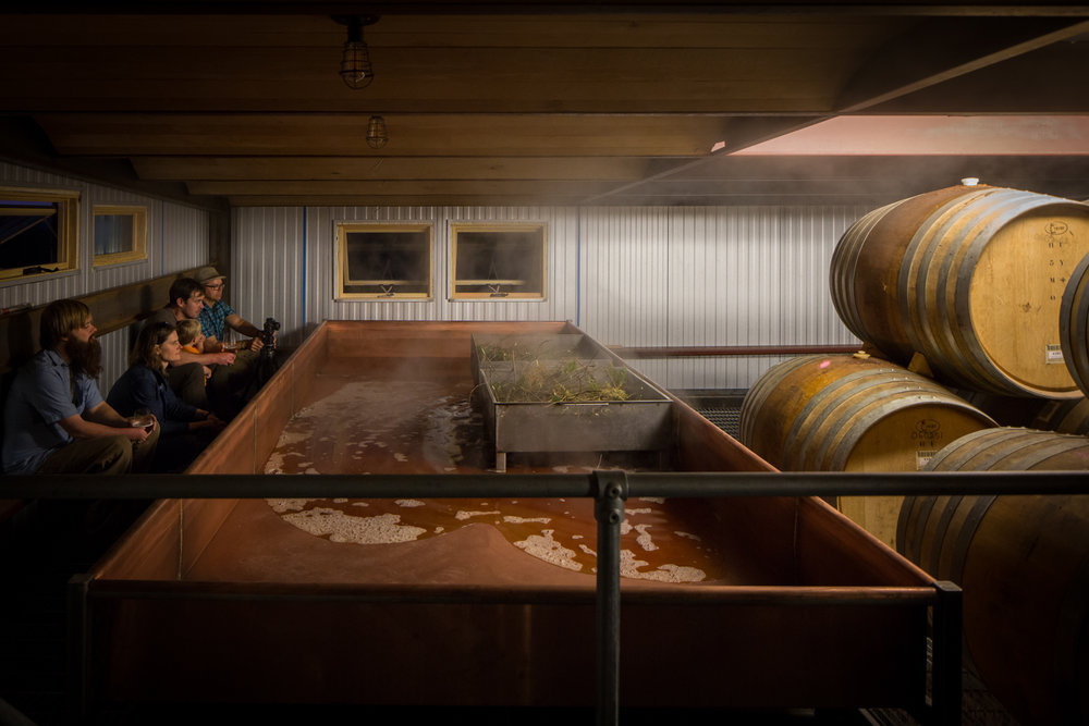 Watching the coolship fill during a collaboration brew between Jester King and Scratch Brewing. Photographed while on assignment in 2016 at Jester King Brewery in Austin, TX. Photo Courtesy of Andrew Pogue Photography.
