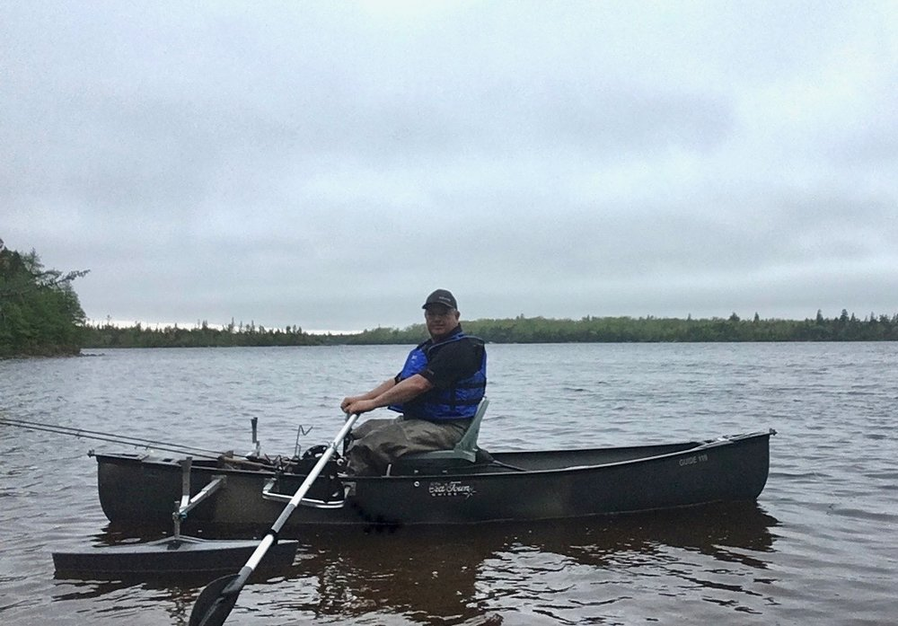 "Steve Harrie in his ""Chironomid Style"" Kit Boat ... during the mayfly hatch somewhere in Nova Scotia. *his oars are backwards in this shot on purpose for a logical reason which I can't remember :)"