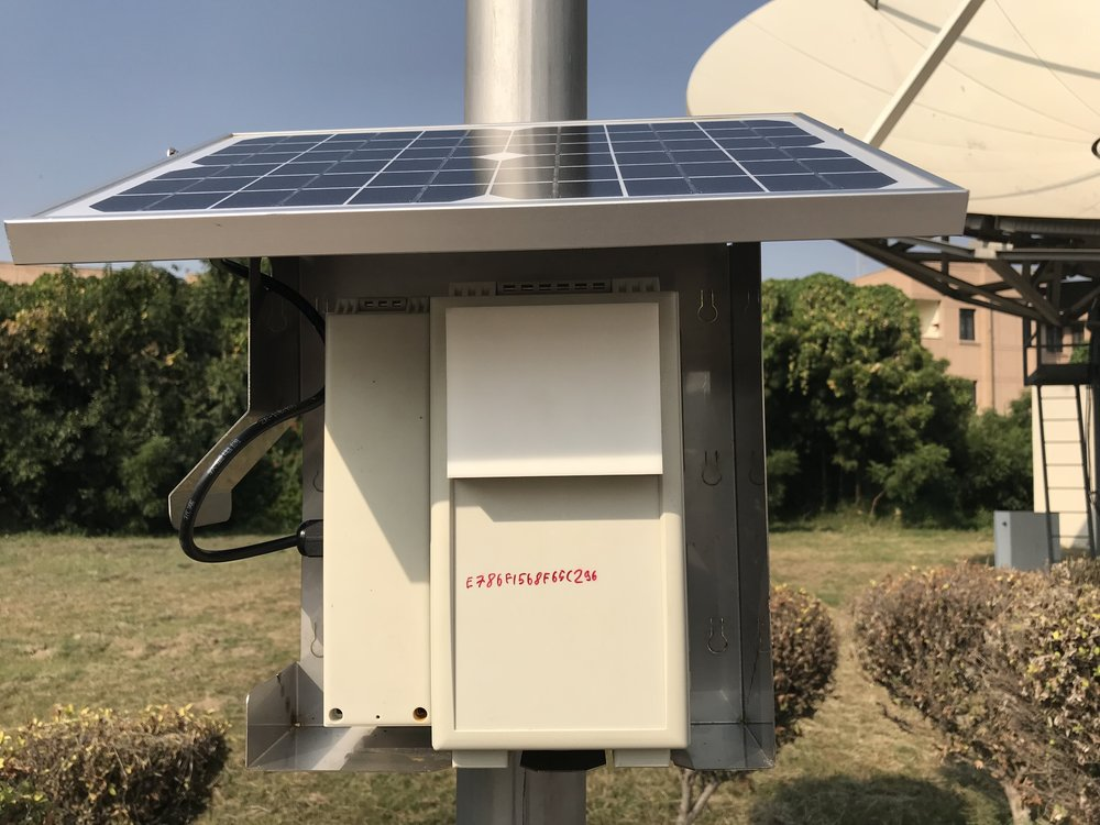 The monitor as deployed in Delhi, India, with its custom sheet metal frame and solar panel