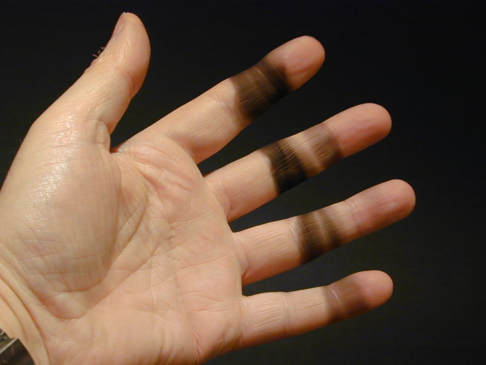 The rest of the unburned particles form this greasy black soot on your fingers. Most of it can be wiped off fairly easily with a paper napkin.  I had repeated the experiment several times before taking this photograph.