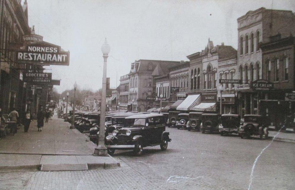 CORNER OF E MAIN STREET & S FORREST STREET, CIRCA 1930
