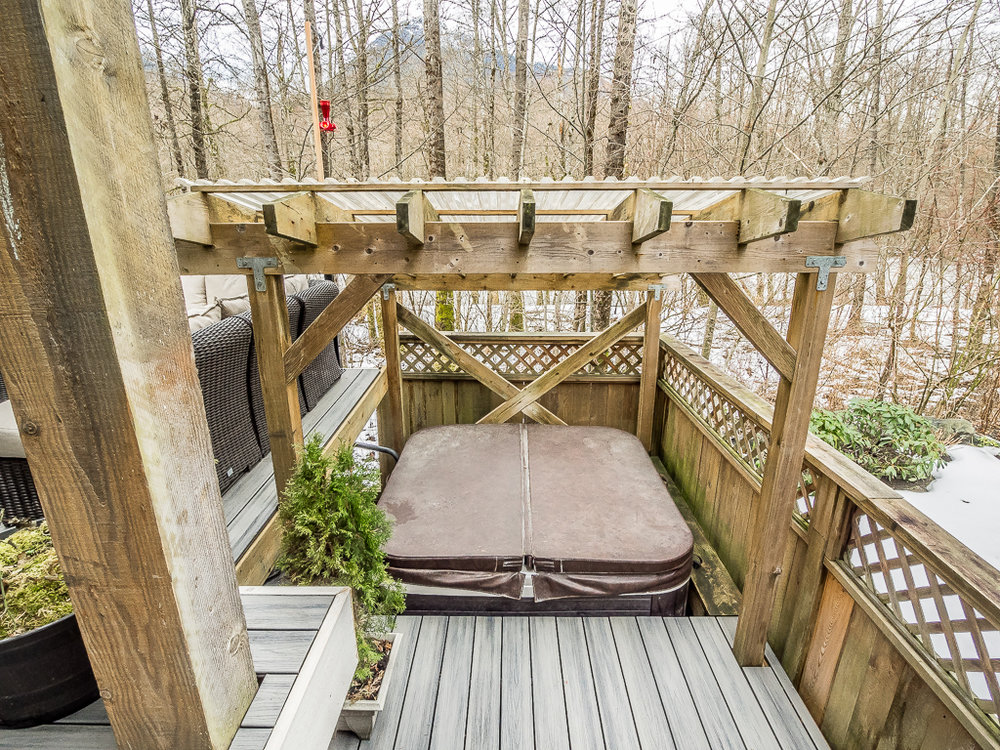 BACK PATIO w HOT TUB 2.JPG