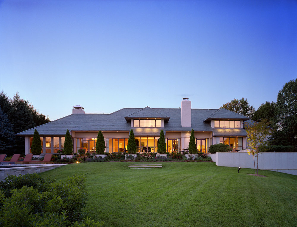 expansive lawn leading to large modern home.jpg