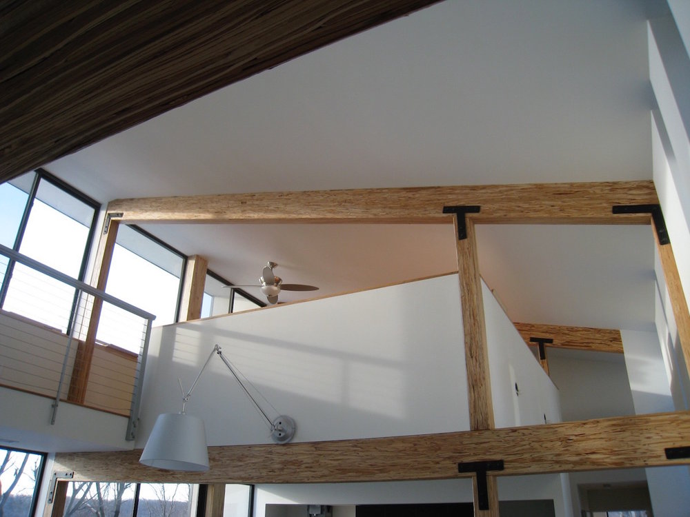 wood beams and floor to ceiling windows