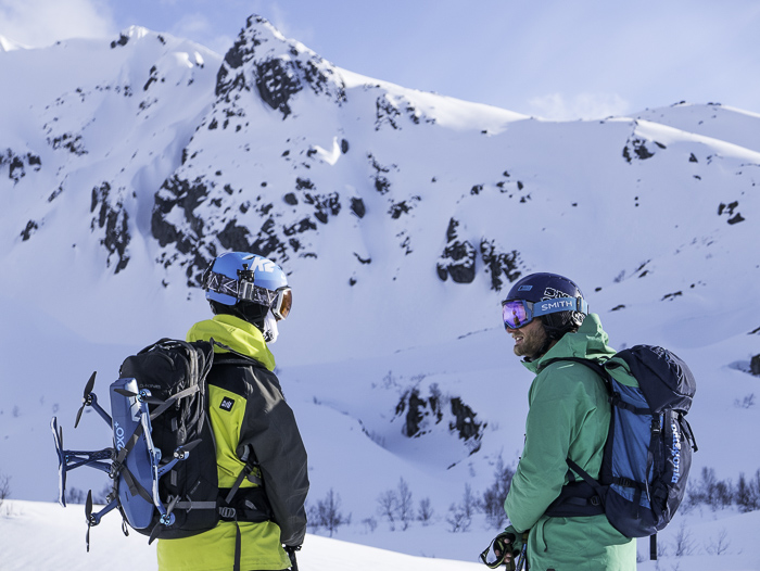 Hamish and I with Hexo+on my back debriefing the awesome lines we skied in the background. Photo: Sophie Stevens