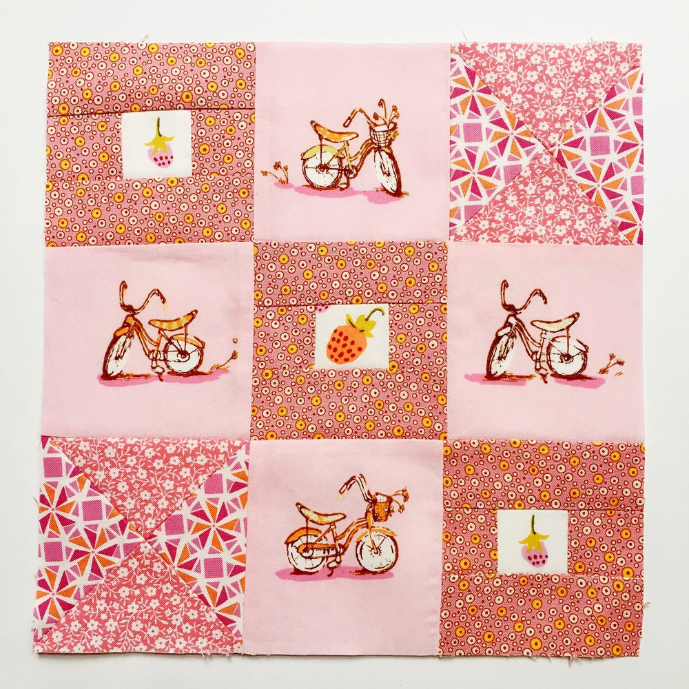 Our guest star, Kim from Go-Go Kim created this sweet block. We love how she used similar colors in her hourglass blocks to really pull the focus to her fussy-cut motifs!