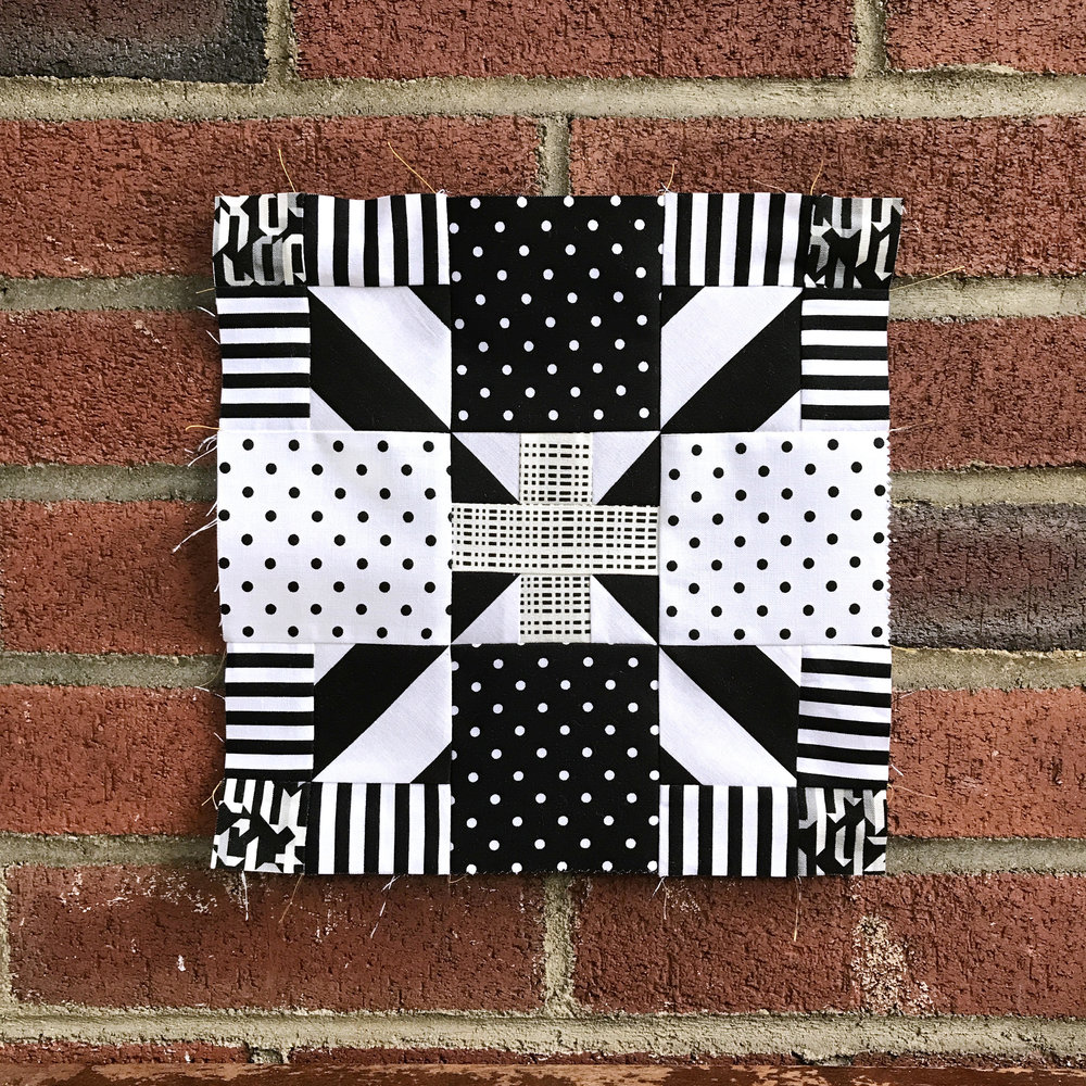 We don't think there's anyone who works better with Geometrics than  Samarra . In fact, her newest fabric collection,  Geogram , is ALL geometrics. When she sent us this block image, we were totally impressed. She manages to make the block flow effortlessly with just black and white and some key directional fussy cuts.