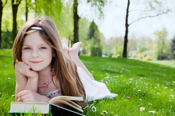 little-girl-reading-book-outside1.jpg