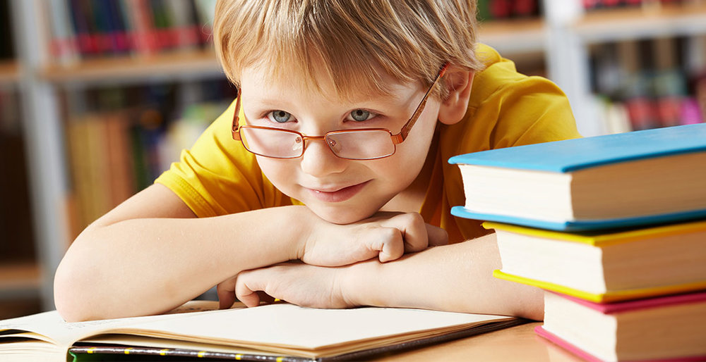 child-with-glasses-reading.jpg