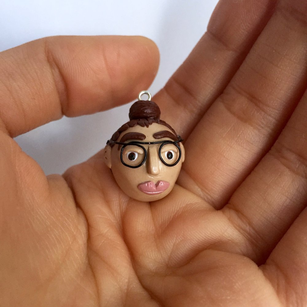 Polymer clay miniature self portrait by Small Things jewelry.