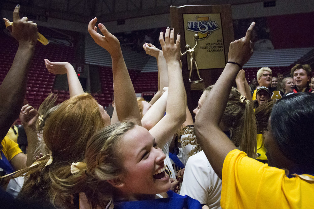 Avon volleyball players celebrate after being given the IHSAA State Championship trophy. The Orioles swept Crown Point in three straight sets, (25-17, 25-18, 25-18) during the 4A State Championship game at Worthen Arena on the Ball State University campus on Saturday, Nov. 4, 2017.  Photos for Indianapolis Star
