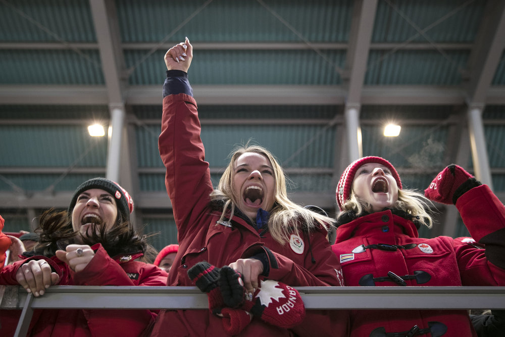 Poland fans cheer loudly during the medal ceremony at doubles bobsleigh, February, 15, at PyeongChang Sliding Center, South Korea. The Olympics is a mecca for patriotic fans. People from all over the world gather together to watch their athletes battle for gold for their country.