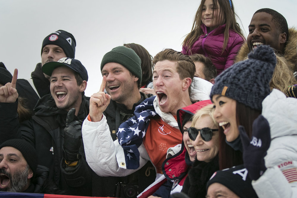 Halfpipe champion snowboarder Shaun White, smiles and cheers with his family and friends in the middle of the halfpipe after winning his third Olympic gold medal in the Men's snowboarding halfpipe finals, Feb. 14, at Phoenix Snow Park.