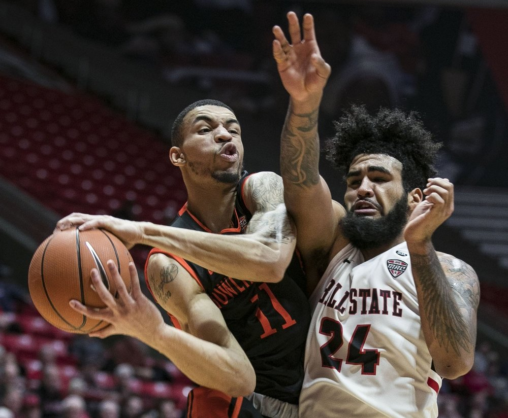 Ball State junior guard Trey Moses reaches for a rebound against a Bowling Green forward , Feb. 6 at John E. Worthen Arena, Muncie, Ind. Ball State defeated Bowling Green in a last second three point buzzer, 59-56.  Photos for Ball State Photo Services, Marketing and Communications