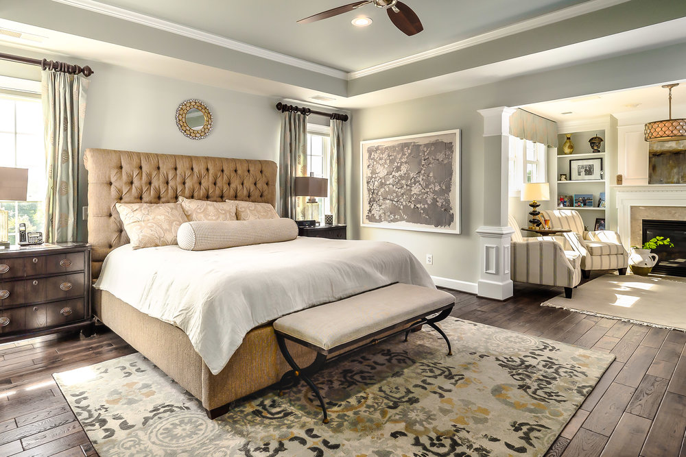 Leesburg real estate photo of master bedroom with sitting area shot by Robert Miller Photography.